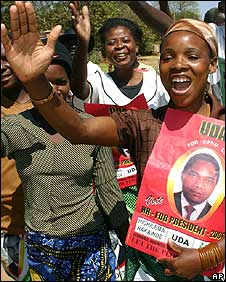Woman with 2006 election poster of Hakainde Hichilema