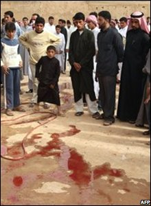 Syrian villagers surround a trail of blood on the ground