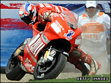 Casey Stoner struggles to get his bike upright at Laguna Seca