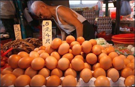A man sells eggs at a market in Hong Kong