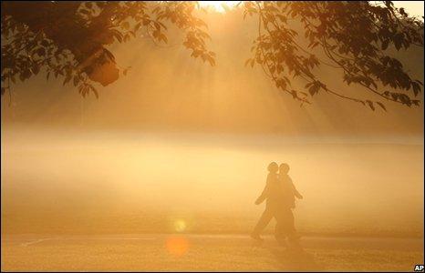 People walk through Prospect Park in Brooklyn, New York.