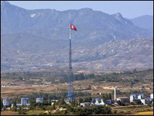 A giant North Korean flag flutters on the top of a tower across the demilitarised zone marking the borther between North and South Korea