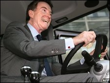 Peter Mandelson at the wheel of a tractor during a business trip to Russia