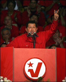 Mr Chavez makes the V sign at a rally in Caracas