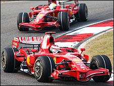 Ferrari's Kimi Raikkonen leads team-mate Felipe Massa