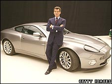 Pierce Brosnan next to a car
