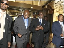 Robert Mugabe (2nd from right) arrives at talks in Harare, 27 October 2008