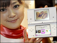 A model shows the latest Nintendo DSi