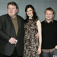 Robbie Coltrane and Rachel Weisz with director Rian Johnson
