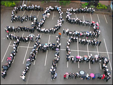 Pupils at Trentham High School form an SOS in the playground