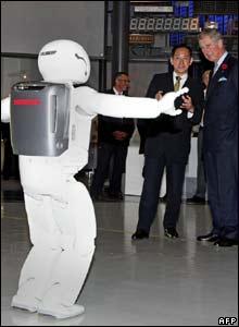 Prince Charles views a humanoid robot in Japan
