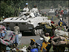 UN tanks in DR Congo on a road where thousands of people are fleeing