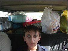 A Christian boy in the back of his family car after fleeing Mosul on 13 October 2008