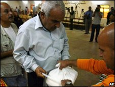 Displaced Iraqi Christians receive food aid from Christians in the northern Iraqi city of Kirkuk on 24 October 2008