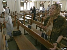 Iraqi Christians pray during a Mass in Baghdad, Iraq on 19 October 2008