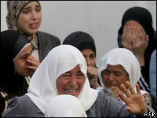 Relatives mourn at the farmer's funeral in the West Bank village of Yamun, 29 Oct