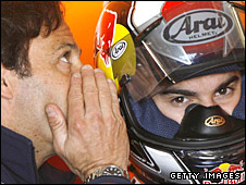 Alberto Puig has a word or two with his rider Dani Pedrosa