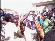 People rush from the scene of a bombing in Hargeisa