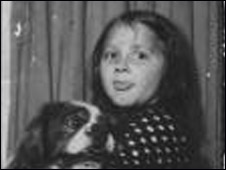 Colete Aram with her pet dog