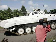 People throwing rocks at a UN tank in Goma