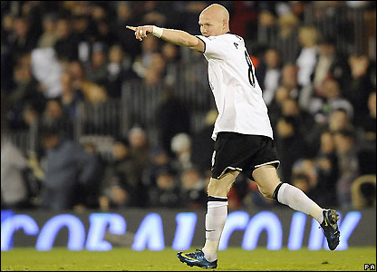 Johnson celebrates his early goal for Fulham