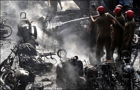 Firemen extinguishing fires at a blast site in Guwahati, Assam