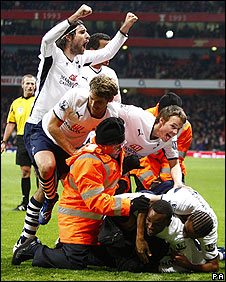 Tottenham celebrate at the Emirates Stadium