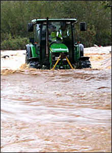 Tractor in floodwater