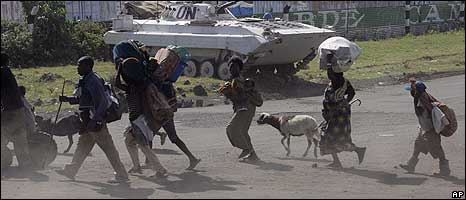 Displaced people running through Goma