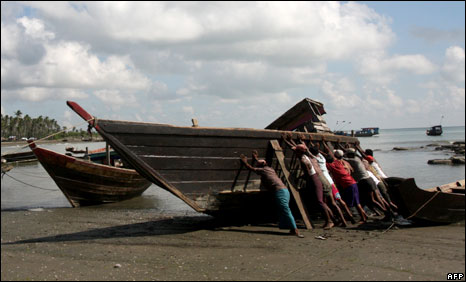 Fishermen try to push along a repaired boat in Ohn-Chaung village, Ngapudaw township, Irrawaddy Delta in October 2008