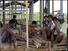Villagers reconstruct their homes in Ohn-Chaung, Ngapudaw township, Irrawaddy Delta in October 2008