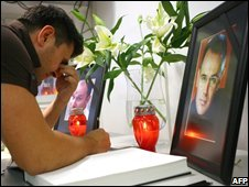 A man weeps at a memorial for the slain men