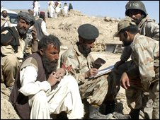 Pakistani quake survivors get registered with the army for relief in Ziarat on 30 October 2008