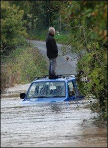 Man standing on car