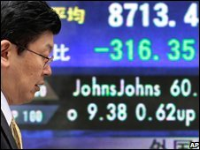 Man walks past electronic stock board in Tokyo, Japan, 31 October 2008