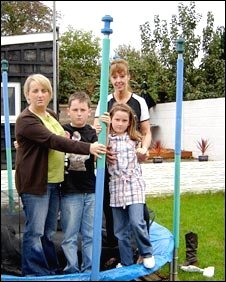 Jenny Brookman and her children with neighbour Janet McCarthy