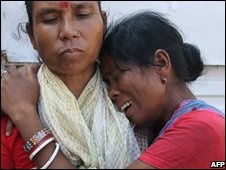 Women mourn the death of loved ones outside the Guwahati Medical College hospital