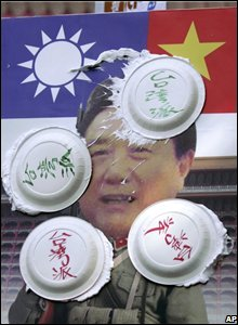 Cream pies thrown at a poster of a Chinese negotiator  to Taiwan.