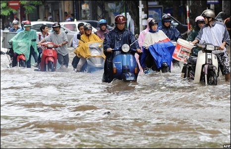 Motorists in Hanoi struggle through flooded streets.