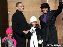 L-R: Sasha, Barack, Malia and Michelle Obama
