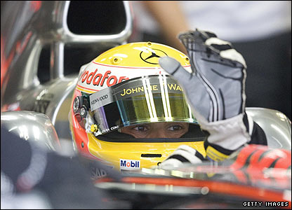 Hamilton dons his driving gloves