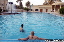 Soldiers relax in Saddam Hussein's swimming pool