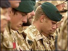 Soldiers praying for fallen colleagues in Lashkar Gah