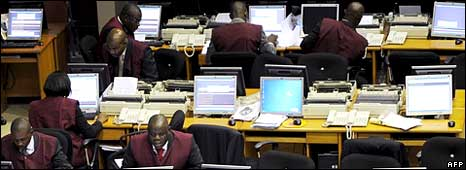 Stockbrokers on the trading floor of the Nigerian Stock Exchange in Lagos