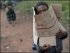 A boy looks out from inside a box near a refugee camp near Goma on 31 October 2008