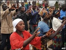 Men and women belonging to a Protestant church sing at a refugee camp near Goma on 31 October 2008