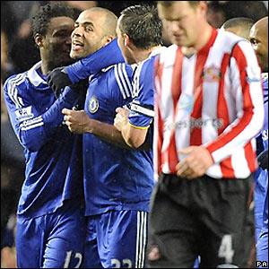 Alex celebrates his goal