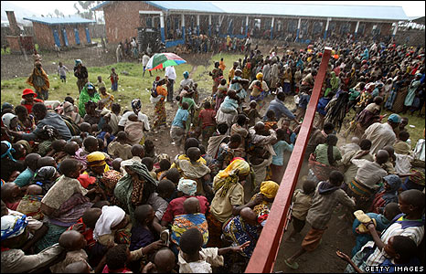 Crowds try to enter a USAid centre near Goma