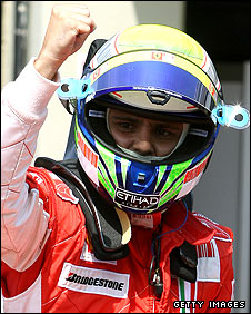 Felipe Massa celebrates taking pole in the Brazilian Grand Prix