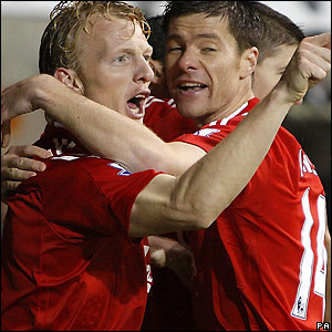 Kuyt celebrates his goal with Xabi Alonso